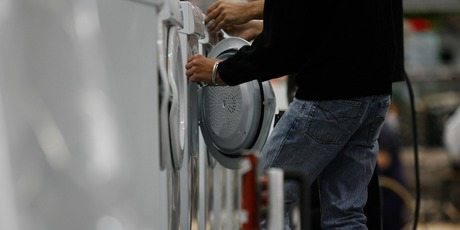 Workers make driers at one of Fisher and Paykel's factories. File photo / Glenn Jeffrey