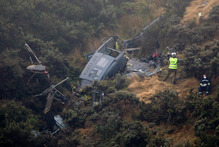 The Iroquois helicopter crashed into a steep hillside near Wellington killing three men. Phot