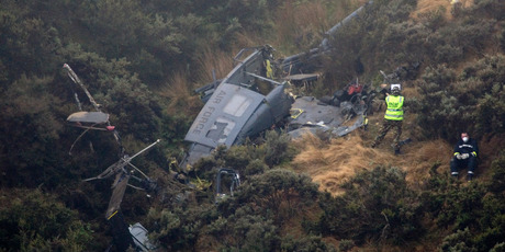 The Iroquois helicopter crashed into a steep hillside near Wellington killing three men. Photo / Mark Mitchell
