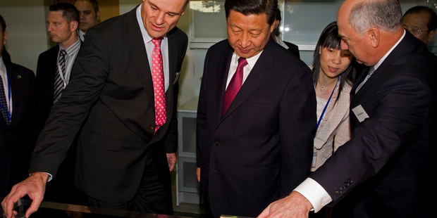 Fisher and Paykel CEO Stuart Broadhurst, left, shows the company's wares to China vice president Xi Jinping during a visit last year.  Photo / NZ Herald