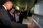 Fisher and Paykel CEO Stuart Broadhurst, left,shows Chinese vice president Xi Jinping around its Auckland factory during a state visit last year. Photo / NZPA