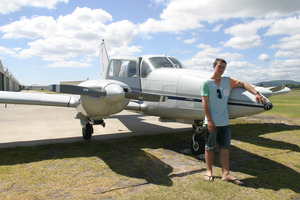 Sam Godfrey, 15, with his favourite plane a Piper PA23 Aztec. Photo / Betty Jeeves