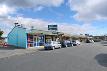 This North Shore retail block is zoned Business 1, which is favourable for future development.