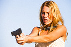 Blake Lively (pictured) and Salma Hayek star as drug dealers in Savages. Photo / Supplied