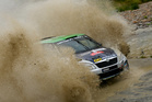 Hayden Paddon and John Kennard tackle a water splash on day one of Wales Rally GB. Photo / Honza Fronek