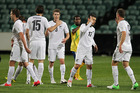 All White Kosta Barbarouses is congratulated by teammates after his goal against the Solomon Islands. Photo / Greg Bowker