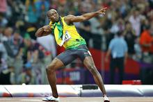 Usain Bolt celebrates winning gold at the London Olympics. Photo / Brett Phibbs