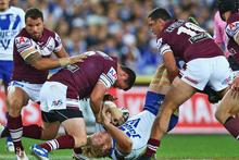 Jason King of the Sea Eagles tackles Bulldogs player Aiden Tolman. Photo / Getty Images