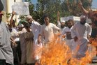 Moroccan protesters burn a US flag in Sale. Photo / AFP