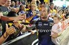 Aaron Payne of the Cowboys acknowledges the crowd with his daughter Naida after the side's final regular season match. Photo / Getty Images