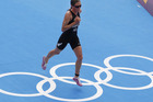 Nicky Samuels runs across the Olympic Rings during the run stage in the women's triathlon at Hyde Park. Photo / Mark Mitchell