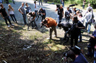 Photographers and cameramen at the scene of last week's shooting near the French village of Chevaline. Photo / AFP