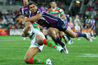 Nathan Merritt of the Rabbitohs is tackled during the match between the Melbourne Storm and the South Sydney Rabbitohs. Photo / Getty Images