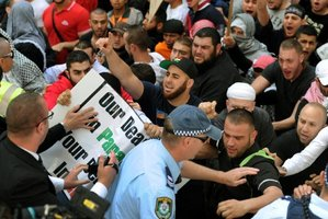 Angry protesters clash with police in Sydney. Photo / AFP