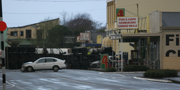 Witnesses at the scene said the driver of a white car tried to do a u-turn in front of the tanker unit. Photo / Horowhenua Chronicle