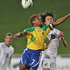Solomon's Henry Fa'arodo and the New Zealand All Whites Ivan Vicelich in action. Photo / Greg Bowker