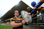 Michael Bent of Taranaki shows the Log o' Wood to some young fans.  Photo / Getty Images