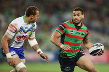Greg Inglis skips around Blake Ferguson. Photo / Getty Images