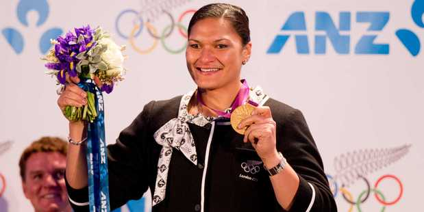 Olympic Gold medallist Valerie Adams receives her London Olympic Medal in Auckland celebrating with her supporters on Wednesday night at the Cloud. Photo / Greg Bowker