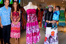 Store manager Vira Tavioni was excited to see the royal couple in a Tav Pacific pink dress (pictured) and blue shirt (as modelled by grandson Taputu). Photos / AP, Sarah Ivey