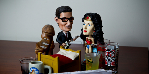 Buddy Holly and Wonder Woman lead the pack of cheap keepsakes collected from travels. Photo / Dean Purcell