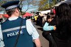A Neighbourhood Policing Team walks the beat around Otahuhu. Photo / Michael Craig