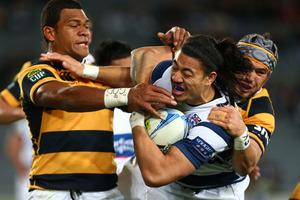 Auckland winger Ben Lam tries to break through Taranaki's Seta Tamanivalu and Jayden Hayward. Photo / Getty Images