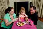 Jessica, Caitlin, 2, and Andrew Miller eat with the TV off.  Photo / Steven McNicholl