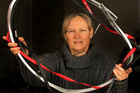 Sirpa Lajunen holds the remains of a bike wheel which was wrapped around her head.  Photo / Alan Gibson