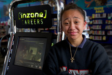Paris Walker, 13, watched a clip from the NZ Army at a kiosk installed at the Otara Library. Photo / Sarah Ivey