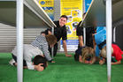 Breakers player Josh Bloxham helps Richard Road School pupils during an earthquake drill. Photo / Chris Gorman