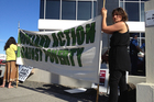 Protestors outside the Ministry of Social Development's Auckland building in Ellerslie . Photo / Dean Purcell