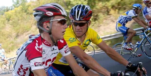 Lance Armstrong (in yellow) and compatriot Tyler Hamilton, who helped author Daniel Coyle lift the lid on doping in cycling. Photo / AFP