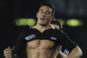 Sonny Bill Williams changing shirts during the World Cup, after his original was ripped off his back. Photo / AP