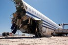 A Boeing 727 that was deliberately crashed in Mexico lost its front section. The first 11 rows of seats were ripped off.  Photo / Vance Jacobs / SWNS.com