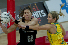 Silver Ferns' shooter Irene van Dyk and Diamonds' goal defence Julie Corletto battle for the ball last night.  Photo / Sarah Ivey