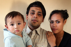 Gaurav Sharma and Tepou Heremaia with their son. Photo / Doug Sherring