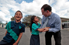 Tarzan Tagoai and Deanne Taaka Te-Kaute with Judd McLauchlan, principal of Rowandale Primary School in Manurewa. Photo / Michael Craig
