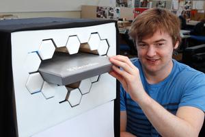 Ben de la Roche demonstrating his revolutionary refrigerator design on a concept model at Massey University's industrial design studio in Wellington. Photo / Mark Mitchell