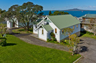 The Castor Bay church is thought to be more than 100 years old. It and the church hall, built in 1933, sit on a 1133sq m block of prime real estate. Photo / Supplied