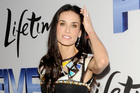 Demi Moore has always been a fan of the low, flat brow.