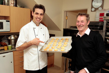 Andre's Extreme Almond Cookies have been a firm favourite since Andre, left, launched his Andre's Kitchen range underneath mother's office. Photo / Michael Craig