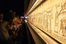 Crowds admire the 70m long Bayeaux Tapestry. Photo / Supplied