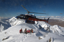 The Harris Mountains Heli-Ski hovers over a mountain peak near Queenstown. Photo / Sarah Ivey