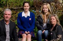 Kim Maree, husband Brian and twin daughters Briahna and Simone (13). Photo / Sarah Ivey