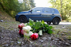 Flowers are seen near the site of the deadly French Alps shooting. Photo / AP