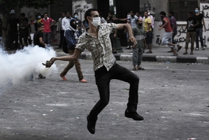A protester near the US embassy in Cairo. Photo / AP