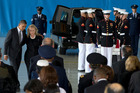 Obama and Clinton paid their respects as the men's remains were returned to US soil. Photo / Carolyn Kaster