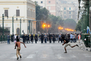 Egyptian protesters hurl stones at riot police in downtown Cairo, Egypt. Photo / Khalil Harma