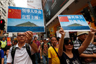 Anti-Japan protesters hold picture of the dipusted island, known as Senkaku in Japanese and Diaoyu in Chinese. Photo / AP